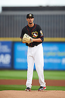 Quad Cities River Bandits pitcher Justin Ferrell (45) gets ready to deliver a pitch the first game of a doubleheader against the Wisconsin Timber Rattlers on August 19, 2015 at Modern Woodmen Park in Davenport, Iowa.  Quad Cities defeated Wisconsin 3-2.  (Mike Janes/Four Seam Images)