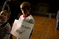 Brendan McCarthy, 9, of Wakefield, holds a Senator Scott Brown (R-MA) campaign sign after a rally at the American Civic Center in Wakefield, Massachusetts, USA, on Thurs., Nov. 2, 2012. Senator Scott Brown is seeking re-election to the Senate.  His opponent is Elizabeth Warren, a democrat.