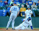 SIOUX FALLS, SD - MAY 20: Al Robbins #21 from South Dakota State slides in safely at home past Evan Miller #21 from IPFW in the second inning Wednesday night at the Sioux Falls Stadium during the Summit League Baseball Tournament. (Photo by Dave Eggen/Inertia)