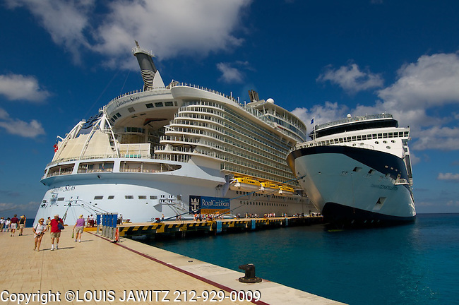 royal caribbean international oasis of the sea cruse ship on left. celebrity constellation cruse ship on right.