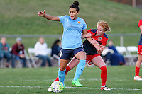 Piscataway, NJ, April 24, 2016.  Raquel Rodriguez (11) of  Sky Blue FC tries to elude the grasp of Tori Huster (23) of the  Washington Spirit.  The Washington Spirit defeated Sky Blue FC 2-1 during a National Women's Soccer League (NWSL) match at Yurcak Field.