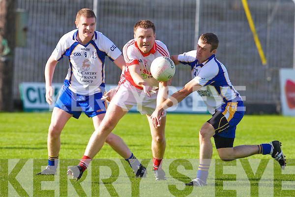 St Pats Joe Costello gets his pass away against Keel's Martin Burke and Aaron Cahillane in the junior championship semi-final at Austin Stack park, Tralee on Saturday.