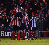 Lincoln City's Neal Eardley celebrates scoring the opening goal with team mates<br /> <br /> Photographer Andrew Vaughan/CameraSport<br /> <br /> The EFL Sky Bet League Two - Cambridge United v Lincoln City - Friday 9th February 2018 - Abbey Stadium - Cambridge<br /> <br /> World Copyright &copy; 2018 CameraSport. All rights reserved. 43 Linden Ave. Countesthorpe. Leicester. England. LE8 5PG - Tel: +44 (0) 116 277 4147 - admin@camerasport.com - www.camerasport.com