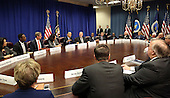 United States President Barack Obama meets with agriculture and business leaders on the benefits of the Trans-Pacific Partnership for American business and workers, at the Department of Agriculture in Washington, Tuesday, Oct. 6, 2015. Flanking the president are Victoria Espinel, CEO, The Software Alliance (left); and Bob Stallman, Jr.,  President, American Farm Bureau.<br /> Credit: Martin H. Simon / Pool via CNP