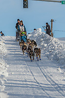 Lev Shvarts on Cordova St. hill during the Anchorage start day of Iditarod 2018 on Cordova St. hill during the Anchorage start day of Iditarod 2019