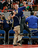 Joyful jump: Oxford head coach Brad Keeney (Left) embraces assistant coach Brandon Rank just seconds before the Wildcats clinched the state-title victory over defending state champs Detroit Catholic Central at Kellogg Arena Saturday. The title was the first in the school's history.