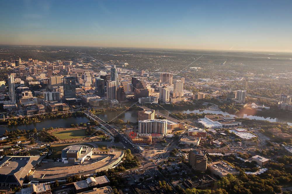 Aerial panoramic view of the Austin Skyline and Lady Bird Lake from a helicopter as Austin, Texas is named No. 1 in the annual list of the 10 fastest growing big cities in America.