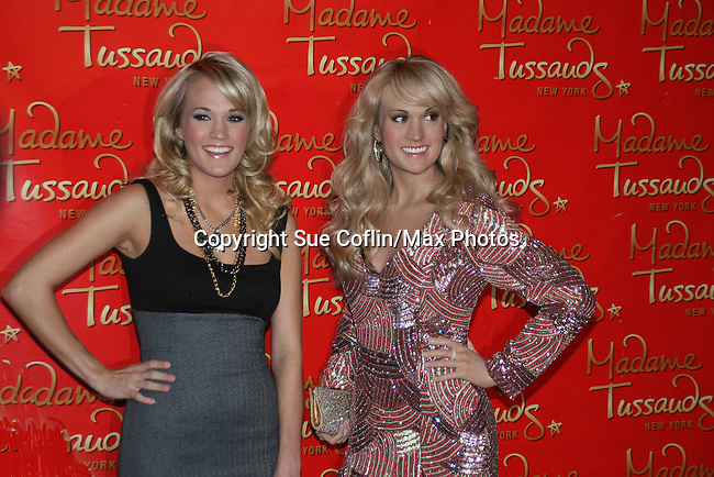 Three Time Grammy Award-winning Recording Artist Carrie Underwood unveils her wax figure at Madame Tussauds New York on October 22, 2008 in New York City. (Photo by Sue Coflin/Max Photos)