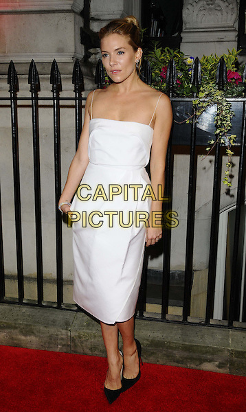 Sienna Miller<br /> attending the BFI Luminous Gala Dinner, 8 Northumberland Avenue, London, England.<br /> 8th October 2013<br /> full length white dress<br /> CAP/CAN<br /> &copy;Can Nguyen/Capital Pictures