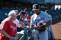 Yusniel Diaz (21), prospect in the Los Angeles Dodgers organization and member of the Glendale Desert Dogs, signs autographs for some fans before an Arizona Fall League game against the Mesa Solar Sox on October 28, 2017 at Sloan Park in Mesa, Arizona. The Solar Sox defeated the Desert Dogs 9-6. (Zachary Lucy/Four Seam Images)