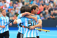 Argentina's Manuel Brunet is congratulated by his team mates after scoring his teams second goal during the Hockey World League Semi-Final match between Argentina and Malaysia at the Olympic Park, London, England on 24 June 2017. Photo by Steve McCarthy.