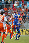 16 May 2015: New York's Leo Fernandes (BRA) (22) heads the ball over Carolina's Neil Hlavaty (4). The Carolina RailHawks hosted the New York Cosmos at WakeMed Stadium in Cary, North Carolina in a North American Soccer League 2015 Spring Season match. The game ended in a 2-2 tie.