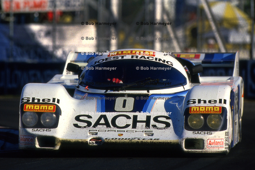 MIAMI, FL - MARCH 2: The Joest Racing Porsche 962 116IM of Gianpiero Moretti and Randy Lanier is driven during the Lowenbrau Grand Prix of Miami IMSA GTP race on the temporary street circuit in Bicentennial Park in Miami, Florida, on March 2, 1986.