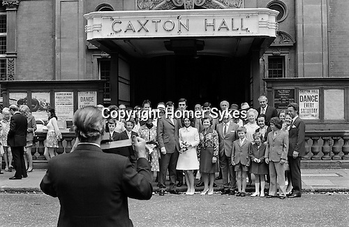 Caxton Hall, Westminster London Uk. Londons main register office untill 1979. Group of people to left of image waiting to go into get married...My ref 23/424/, 1972.