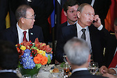 President Vladimir Putin of Russia takes a call during a luncheon hosted by United Nations Secretary-General Ban Ki-moon (L) during the 70th annual UN General Assembly at the UN headquarters September 28, 2015 in New York City. U.S. President Barack Obama will hold a bilateral meeting with Putin later in the day. <br /> Credit: Chip Somodevilla / Pool via CNP