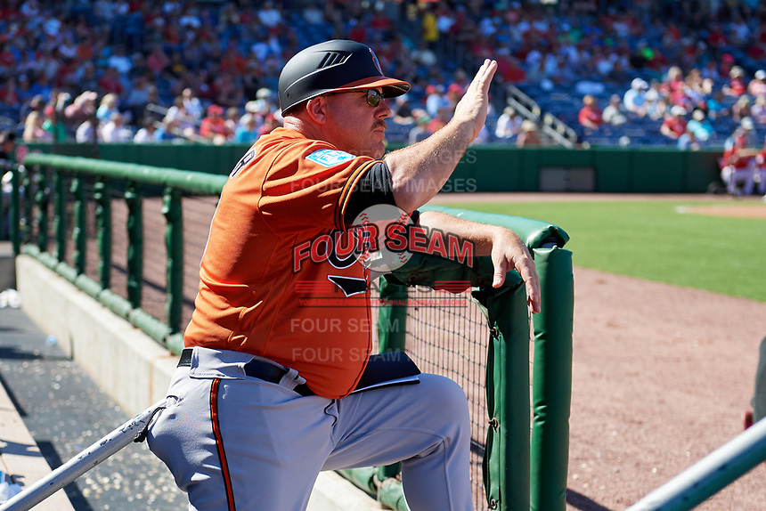 Baltimore Orioles first base coach Arnie Beyeler (13) instructs defensive players from the dugout during a Grapefruit League Spring Training game against the Philadelphia Phillies on February 28, 2019 at Spectrum Field in Clearwater, Florida.  Orioles tied the Phillies 5-5.  (Mike Janes/Four Seam Images)