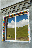 Reflection in a Tibetan window.