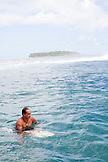 FRENCH POLYNESIA, Moorea. Local surfers in the water.