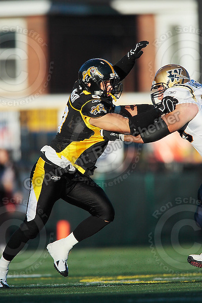 Aug 3, 2007; Hamilton, ON, CAN; Winnipeg Blue Bombers play the Hamilton Tiger-Cats at Ivor Wynne Stadium. The Tiger-Cats defeated the Blue Bombers 43-22. Mandatory Credit: Ron Scheffler. Pictured here is Hamilton Tiger-Cats defensive lineman (9) Nautyn McKay-Loescher.