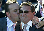 Trainer Lee Freedman reacts as he recieves a kiss on the cheek from a happy friend after winning the 2003 Caulfield Cup aboard Mummify. - pic by Trevor Collens.