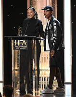 BEVERLY HILLS - NOVEMBER 3: Alicia Keys and Pharrell Williams appear onstage at the 2019 Hollywood Film Awards at the Beverly Hilton on November 3, 2019 in Beverly Hills, California. (Photo by Frank Micelotta/PictureGroup)