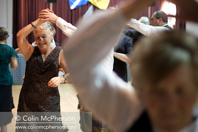 Guests dancing at a St. Andrew's dinner dance held by the Sandbach and District Caledonian Society at Sandbach Town Hall, Cheshire, England on St. Andrew's Day. Around 40 people from the Society attended the meal and dance which included a programme of Scottish country dancing. St. Andrew was the patron saint of Scotland and the day was celebrated by Scots worldwide on the 30th November.