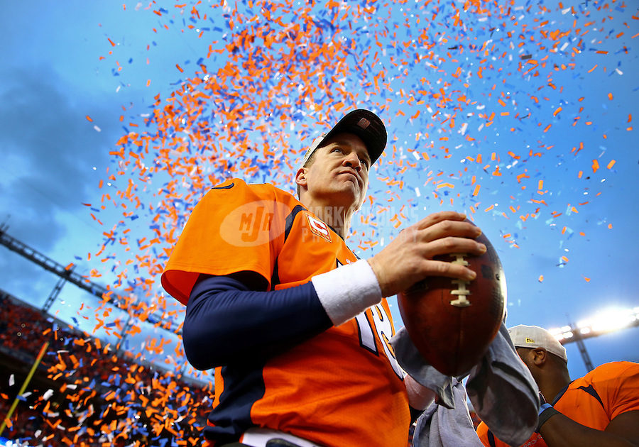 Jan 24, 2016; Denver, CO, USA; Confetti falls behind Denver Broncos quarterback Peyton Manning (18) following the game against the New England Patriots in the AFC Championship football game at Sports Authority Field at Mile High. The Broncos defeated the Patriots 20-18 to advance to the Super Bowl. Mandatory Credit: Mark J. Rebilas-USA TODAY Sports