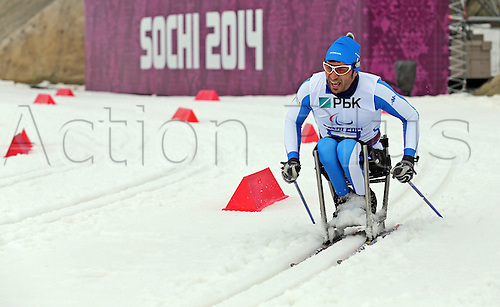07.03.2014. Sochi, Russia.  An athlete from team Italy practices Cross Country - Sitting during a training session at Laura Cross-country Ski & Biathlon Center at the Sochi 2014 Paralympic Winter Games, Krasnaya Polyana, Russia, 07 March 2014.