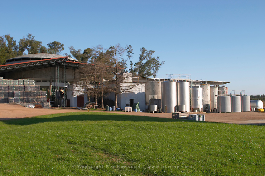 The winery with some outside stainless steel and painted steel fermentation vats. Bodega Juanico Familia Deicas Winery, Juanico, Canelones, Uruguay, South America