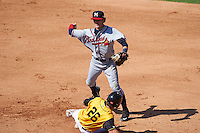 Mississippi Braves shortstop Dansby Swanson (36) throws to first as Avery Romero (26) slides in during a game against the Jacksonville Suns on May 1, 2016 at The Baseball Grounds in Jacksonville, Florida.  Jacksonville defeated Mississippi 3-1.  (Mike Janes/Four Seam Images)