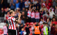 Lincoln City's Jordan Maguire-Drew applauds the fans at the final whistle <br /> <br /> Photographer Chris Vaughan/CameraSport<br /> <br /> The EFL Sky Bet League Two - Lincoln City v Morecambe - Saturday August 12th 2017 - Sincil Bank - Lincoln<br /> <br /> World Copyright &copy; 2017 CameraSport. All rights reserved. 43 Linden Ave. Countesthorpe. Leicester. England. LE8 5PG - Tel: +44 (0) 116 277 4147 - admin@camerasport.com - www.camerasport.com