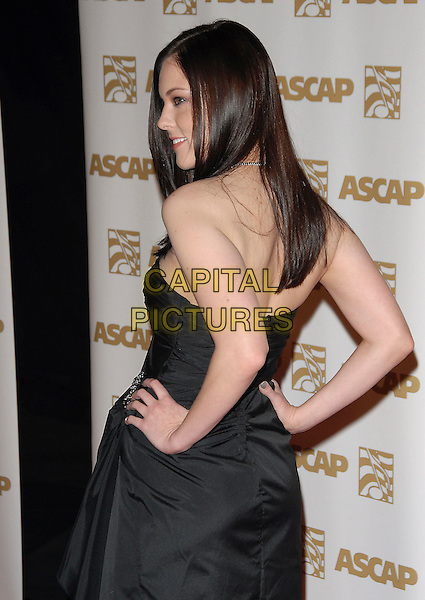 ANNA NALIK .Attends The ASCAP Pop Awards held at The Kodak Theatre in Hollywood, California on .April 18th, 2007.half length black dress hands on hips profile back behind rear .CAP/DVS.©Debbie VanStory/Capital Pictures