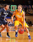 BROOKINGS, SD - DECEMBER 11:  Tara Heiser #12 from South Dakota State University drives against Dara Taylor #2 from Penn State in the first half of their game Wednesday night at Frost Arena in Brookings. (Photo by Dave Eggen/Inertia)