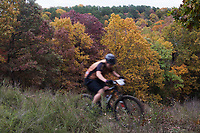 NWA Democrat-Gazette/CHARLIE KAIJO A rider competes during a bike race, Sunday, November 4, 2018 at Lake Leatherwood MTB Park in Eureka Springs.<br />