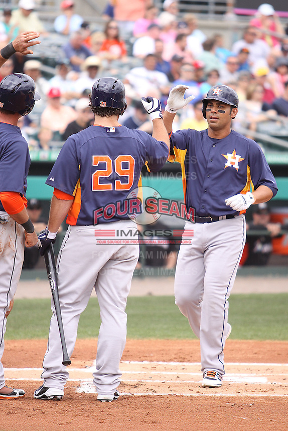 Houston Astros Carlos Pena (12) is congratulated by his teammates after he hit a home run against the Miami Marlins during a spring training game at the Roger Dean Complex in Jupiter, Florida on March 12, 2013. Houston defeated Miami 9-4. (Stacy Jo Grant/Four Seam Images)........