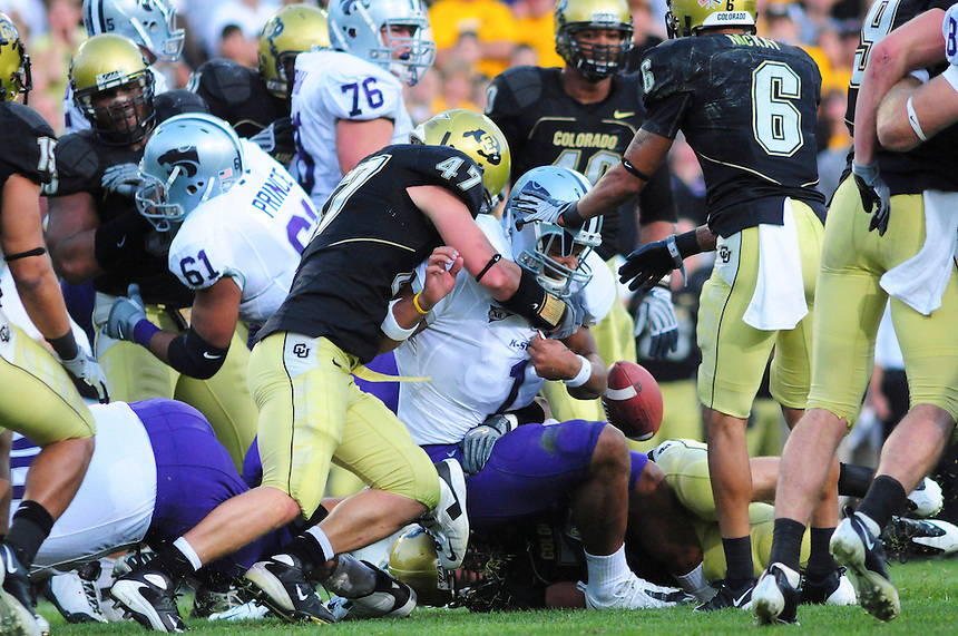 18 October 08: Colorado linebacker Shaun Mohler (47) forces Kansas State quarterback Josh Freeman to fumble. The Colorado Buffaloes defeated the Kansas State Wildcats 14-13 at Folsom Field in Boulder, Colorado.