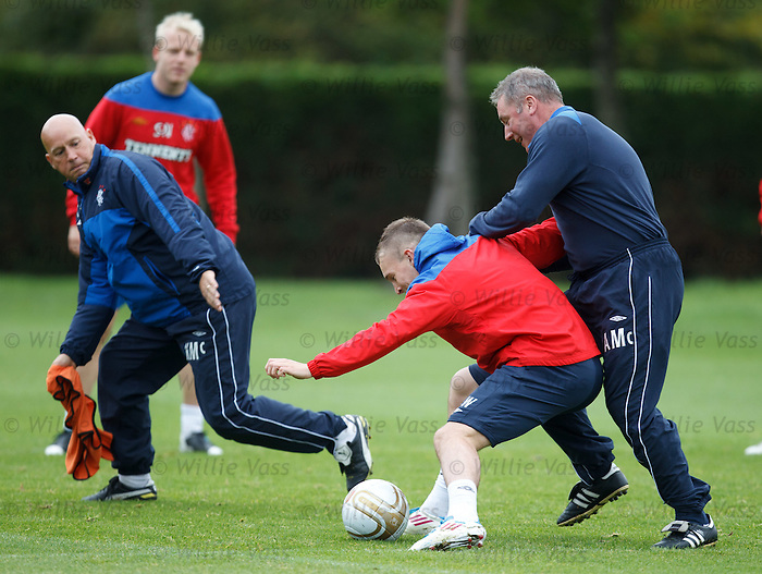 Ally McCoist resorts to fouling Gregg Wylde to get the ball off him