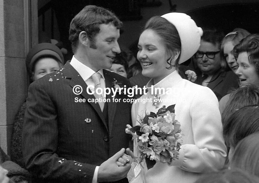 N Ireland international and Arsenal FC footballer,Terry Neill, with his bride, Sandra Lichfield, after their wedding in First Bangor Presbyterian Church, Bangor, Co Down, N Ireland, 4th November 1969. They met in March that year in Malta whilst Terry was touring with Arsenal and she was on a modelling assignment. 196911040256a<br />