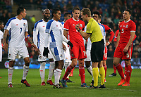 Referee Bart Vertenten speaks to Manuel Vargas of Panama (6) during the international friendly soccer match between Wales and Panama at Cardiff City Stadium, Cardiff, Wales, UK. Tuesday 14 November 2017.