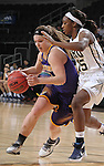 SIOUX FALLS, SD - MARCH 6:  Emily Clemens #15 of Western Illinois dribbles past defender Faith Ihim #15 of Oral Roberts in the 2016 Summit League Tournament.  (Photo by Dick Carlson/Inertia)