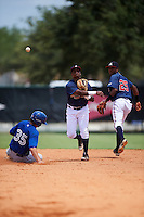 GCL Braves shortstop Nicholas Shumpert (92) throws to first as Matt Dean (35) slides into second base with Luis Ovando (25) backing up the play during a game against the GCL Blue Jays on August 5, 2016 at ESPN Wide World of Sports in Orlando, Florida.  GCL Braves defeated the GCL Blue Jays 9-0.  (Mike Janes/Four Seam Images)