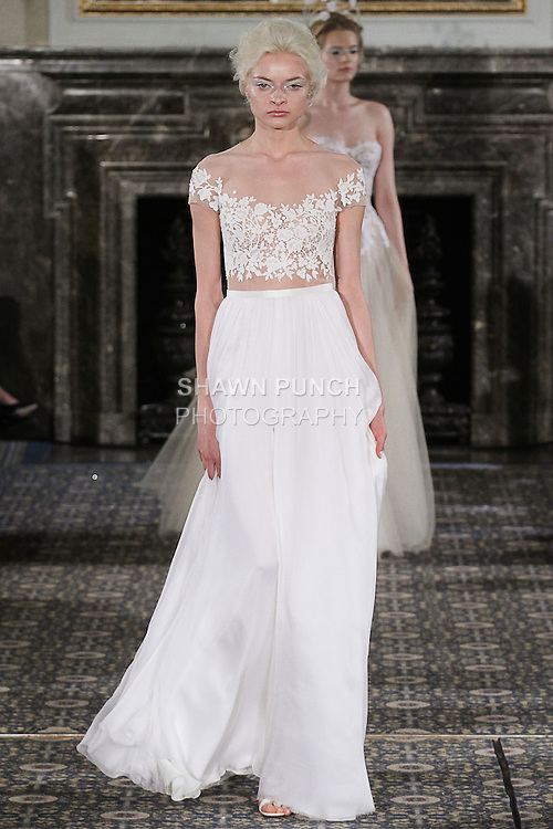 Model walks runway in a bridal gown from the Mira Zwillinger Spring 2016 bridal collection, during New York Bridal Week, on April 17, 2015.