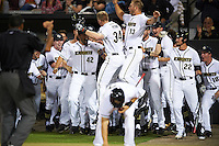 UCF Knights right fielder Eli Putnam (34) celebrates with teammates, including Trent Thompson (42), Bryce Peterson (13), Kyle Marsh (22), and Anthony George (10), after hitting a home run during a game against the Siena Saints on February 17, 2017 at UCF Baseball Complex in Orlando, Florida.  UCF defeated Siena 17-6.  (Mike Janes/Four Seam Images)