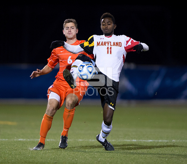Mikias Eticha (11) of Maryland controls the ball in front of Paul Clowes (6) of Clemson during the ACC tournament semifinals at the Maryland SoccerPlex in Boyds, MD.  Maryland defeated Clemson, 1-0, in overtime.