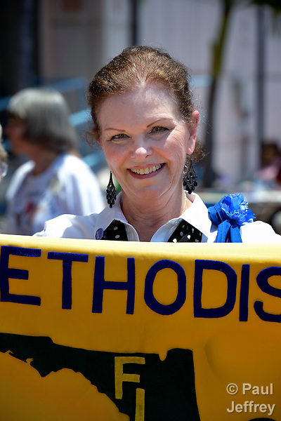 Jean Luker, president of the Southwest District United Methodist Women in the Florida annual conference, joins UMW members and their friends from around the world in an April 28 rally against private prisons held at the 2012 United Methodist General Conference in Tampa, Florida. The rally was sponsored by United Methodist Women and the United Methodist Task Force on Immigration.