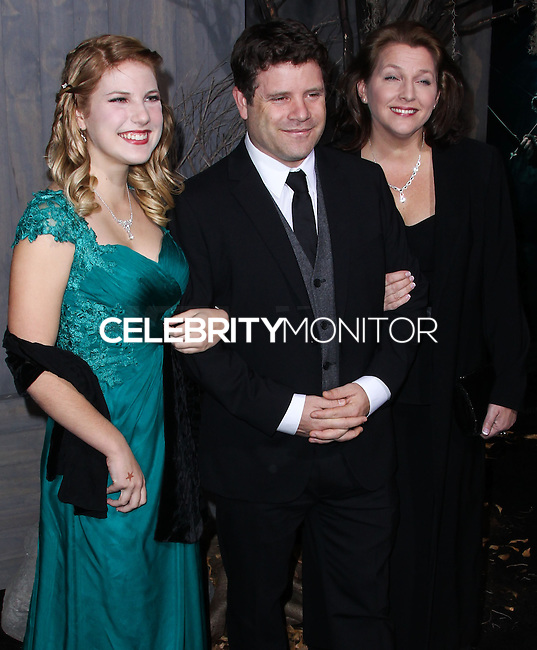 """HOLLYWOOD, CA - DECEMBER 02: Sean Astin, Christine Harrell Astin, Alexandra Astin arriving at the Los Angeles Premiere Of Warner Bros' """"The Hobbit: The Desolation Of Smaug"""" held at Dolby Theatre on December 2, 2013 in Hollywood, California. (Photo by Xavier Collin/Celebrity Monitor)"""