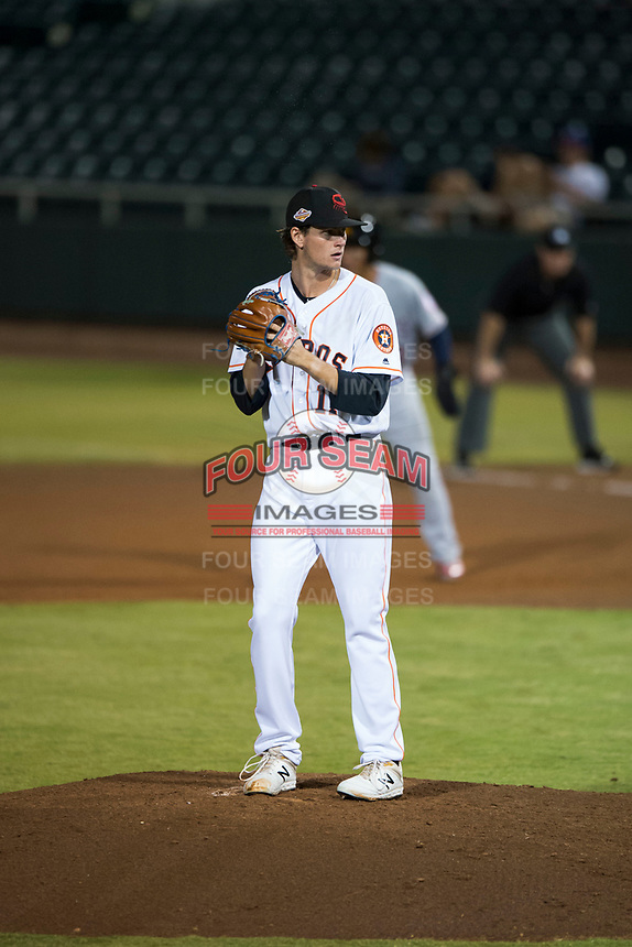 Scottsdale Scorpions starting pitcher Forrest Whitley (11), of the Houston Astros organization, gets ready to deliver a pitch during an Arizona Fall League game against the Mesa Solar Sox on October 9, 2018 at Scottsdale Stadium in Scottsdale, Arizona. The Solar Sox defeated the Scorpions 4-3. (Zachary Lucy/Four Seam Images)