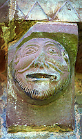 Norman Romanesque exterior corbel no 40 - sculpture of a mans head.  The Norman Romanesque Church of St Mary and St David, Kilpeck Herefordshire, England. Built around 1140