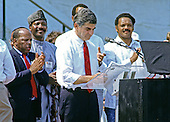 Governor Michael Dukakis (Democrat of Massachusetts), the 1988 Democratic Party nominee for President of the United States, delivers remarks at the 25th anniversary commemoration of Dr. Martin Luther King, Jr's March on Washington on the steps of the Lincoln Memorial in Washington, DC on August 27, 1988.  Pictured from left to right: Mayor Andrew Young (Democrat of Atlanta, Georgia), United States Representative John Lewis (Democrat of Georgia), unidentified, Governor Dukakis, and the Reverend Jesse Jackson.<br /> Credit: Ron Sachs / CNP