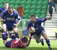 Sport - Rugby 28/04/2002 Parker Pen Shield - Semi-Final.Gloucester vs Sale - Franklin Gardens - Northampton.Chris Fortey hang's onto Bryan redpath's shirt...[Mandatory Credit, Peter Spurier/ Intersport Images].
